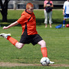 Beverly U-14 soccer player Jake Brodbine winds up and strikes a penalty kick against Georgetown during the Danvers Invitational Tournament on Monday. David Le/Staff Photo