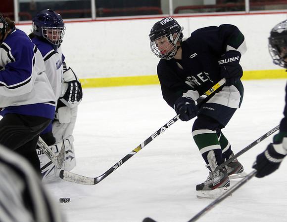 Pingree's Olivia Carmichael, right, walks in on Dana Hall goalie Jennifer Barrack. David Le/Staff Photo