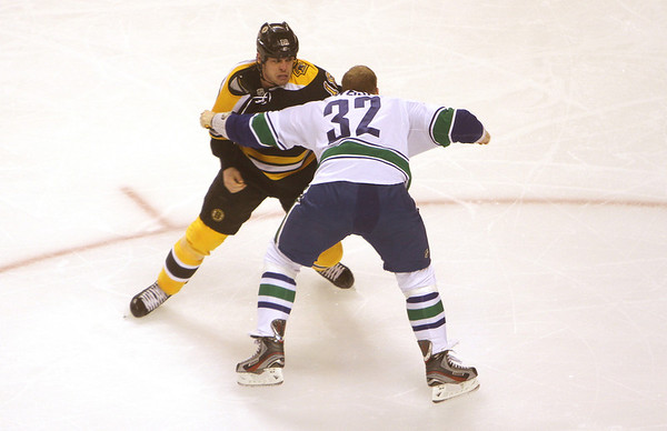 Bruins foward Nathan Horton and Vancouver's Dale Weise exchange blows during a fight in the first period. David Le/Salem News