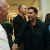 Newly elected Ipswich Selectman Nishan Mootafian, right, is congratulated by Pat McNally, a member of the Ipswich Board of Selectman, following the announcement of the Ipswich Elections on Tuesday evening at the Ipswich YMCA. David Le/Staff Photo