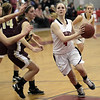 Marblehead'sEmily Freedland (4) drives into the lane against Gloucester on Tuesday. David Le/Salem News