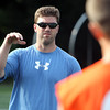 Former St. John's Prep quarterback Brian St. Pierre provides instruction during a practice with current Eagles players on Tuesday afternoon. David Le/Staff Photo