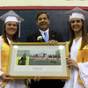 North Shore Tech Senior Class President, Courtney Raymond, left, and Senior Class Secretary Brianna Reynolds, right, present Senator Bruce Tarr with a plaque following his speech on Friday evening.  David Le/Staff Photo