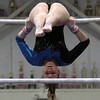 Danvers gymnast Aimee LeBlanc hangs upside-down on the bars on Friday night. David Le/Salem News
