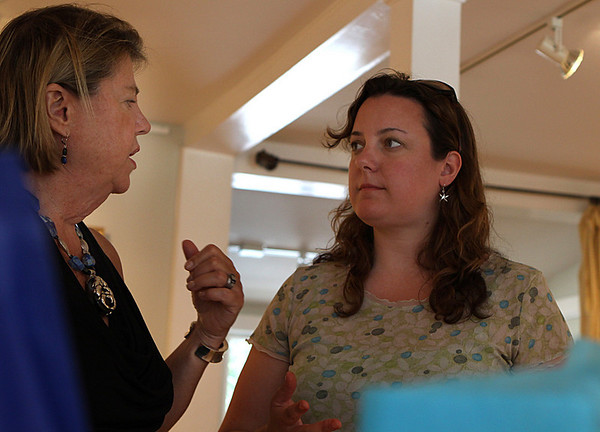 Ipswich: Pam Morss of Manchester, talks with Barbara DiLorenzo owner of Wavepaint Design and Gallery in Ipswich. DiLorenzo held a silent auction at her studio on Saturday afternoon to support Partners in Development and their work in Haiti. Photo by David Le/Salem News