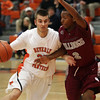 Beverly's Chris Keaton (33) left, drives to the hoop past Lynn English's Fred Hogan (2). David Le/Salem News