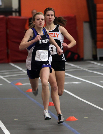 Peabody's Heather MacLean, left, and Beverly's Catelin Harty compete in the 300m race on Thursday afternoon. David Le/Salem News