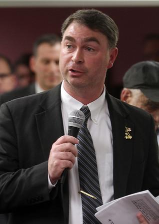 State Representative Brad Hill addresses MBTA officials regarding the proposed MBTA plan to cut services and increase fares. David Le/Salem News
