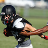 Marblehead senior Sam Stern breaks away from a tackle during a joint scrimmage with Ipswich High School on Wednesday afternoon. David Le/Staff Photo
