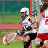 Masco goalie Lili Miller makes a key save against Beverly on Tuesday afternoon, to preserve the Chieftans lead and propel them to an 11-7 victory in the first round of the tournament. David Le/Staff Photo