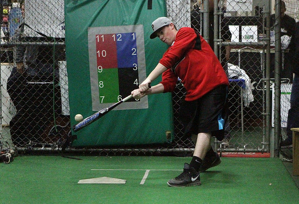 David Le/Salem News. Joe Klingensmith, a sophomore at Masco High School tries out a new bat at Extra Innings in Middleton on Thursday night.