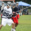 Danvers: St. John's Prep Junior attackman Matt Scalise looks to get past the Lincoln-Sudbury defenseman in the Eagles' Division 1 Semi-Final Game held on Saturday afternoon in Danvers. Photo by David Le/Salem News