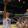 Danvers senior captain George Merry, left, hoists the D3 North Championship high over his head and shows the fans as junior captain Eric Martin, right, starts to celebrate following the Falcons' victory over Saugus. David Le/Staff Photo