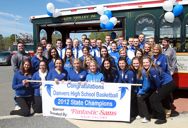 The 2011-2012 State Champion Danvers Falcons Basketball Team and their Cheerleaders pose for a photo in front of the Salem Trolley after leading the Danvers Little League Parade on Saturday morning. David Le/Staff Photo