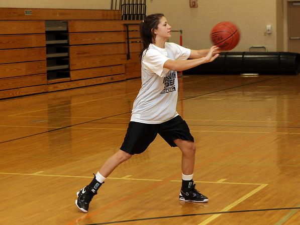 Ipswich High School's Masey Zegarowski passes the ball to a teammate on Thursday. David Le/Salem News