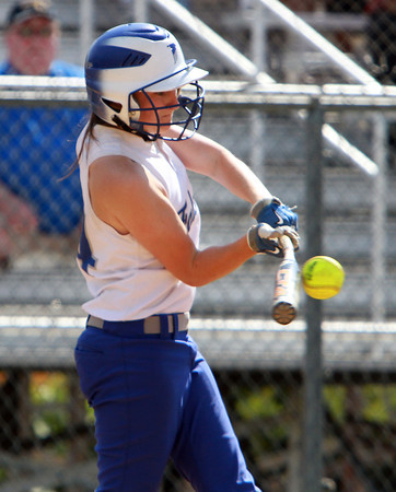 Danvers sophomore pitcher Kendall Meehan makes solid contact off Dracut starter Lauren Ramirez on Sunday afternoon. David Le/Staff Photo