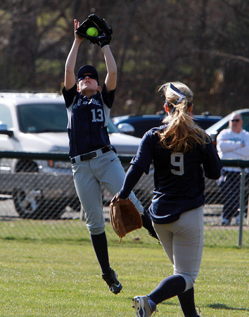 Swampscott left fielder Samantha Rizzo (13) leaps and makes a catch as shortstop Lindsay Mirini (9) looks on. David Le/Staff Photo