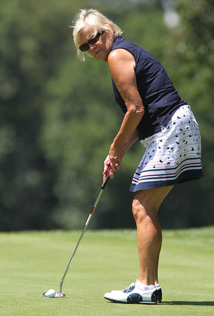 Salem Country Club member Andrea Bruno, of Lynnfield, lines up a putt on the green of the 13th hole, during the 20th Annual Make-A-Wish Massachusetts and Rhode Island Golf Tournament, held at the Salem Country Club in Peabody on Monday afternoon. David Le/Staff Photo
