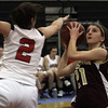Gloucester's Katie Ciaramitaro (21) right, goes up for a layup while being defended by Marblehead's Kathryn DiGiammarino (2) left. David Le/Staff Photo