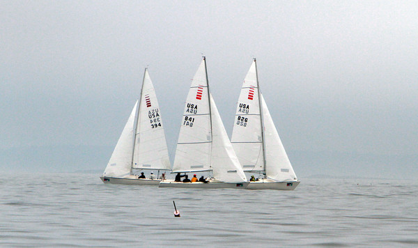 A cluster of boats pass each other out on the water during Race Week in Marblehead . David Le/Staff Photo