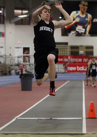 Beverly long jumper Kenny Pierce soars in the air after completing a jump. David Le/Salem News