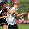 Beverly's Katherine Creamer, right, loses control of the ball as Marblehead's Peyton Weston, left, applies defensive pressure. The Magicians defeated the Panthers 16-6 on Wednesday afternoon. David Le/Staff Photo