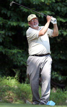 Bob Avellino, of Peabody, follows his tee shot from the box on the 17th hole on Wednesday afternoon. David Le/Staff Photo