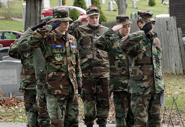 Young members of the Civil Air Patrol from Beverly salute the American flag during the singing of the National Anthem on Saturday as part of a Wreaths Across America ceremony. David Le/Salem News