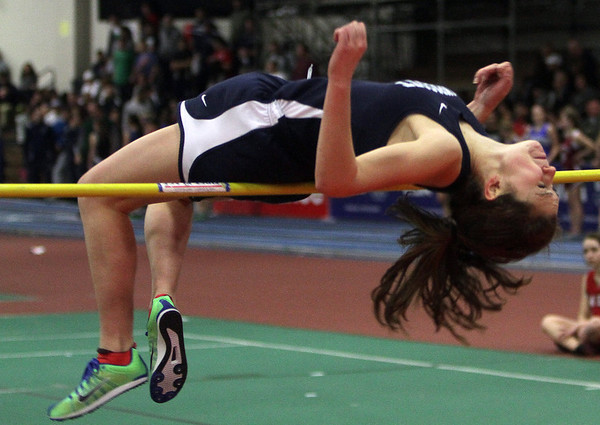Swampscott high jumper Emma Walsh arches her back as she soars over the bar at the NEC Conference Meet. David Le/Salem News