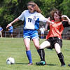 Danvers Girls U-14 Tornados player Devon Walsh, left, controls the ball against a Woburn defender during the Danvers Invitational Tournament on Monday morning. David Le/Staff Photo