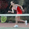 Masconomet 1st Doubles player Rebecca Costa concentrates on returning a volley against Marblehead on Wednesday afternoon. David Le/Staff Photo