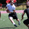 St. John's Prep receiver Alex Moore looks for room to run against Gloucester after catching a pass while playing in a 7 on 7 Tournament at Bishop Fenwick High School on Saturday. David Le/Staff Photo