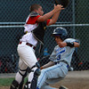 Danvers American centerfielder Jackson Leete, right, slides in safely to home plate as Gloucester American catcher Marc Smith cannot hold onto the ball at a close play at the plate on Friday evening at Harry Ball Field. David Le/Staff Photo