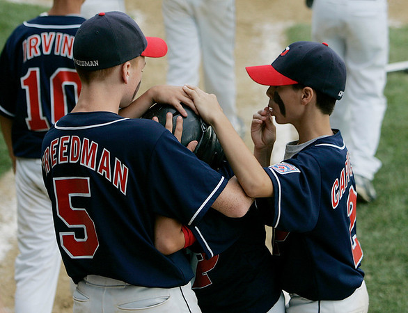 Norwood: Peabody West players Josh Freedman, left, and Marco Cappuccio, right, console Steve Guttadauro after Peabody West's 10-4 defeat in the Massachusetts Little League State Championship at Kelly Field in Norwood on Sunday afternoon. Photo by David Le/Salem News