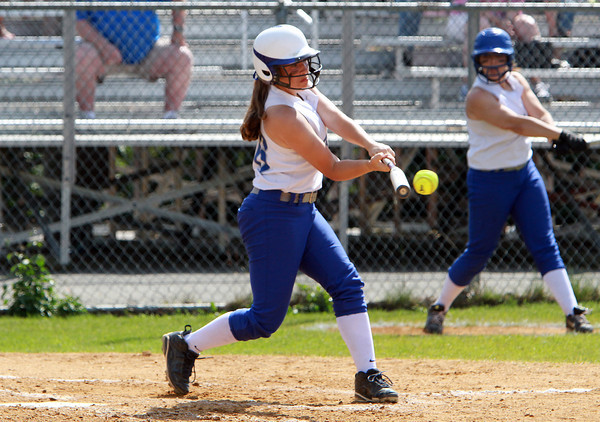 Danvers High School first baseman Devyn Downs makes contact against Dracut on Sunday afternoon. David Le/Staff Photo