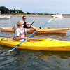 Kate Seymour and Josh Ford, both of Marblehead, kayak around Marblehead Harbor on Friday afternoon. David Le/Staff Photo