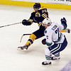 Bruins defenseman Johnny Boychuck goes flying after being hooked down by Vancouver's Daniel Sedin. David Le/Salem News