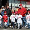 The Danvers American Angels parade through Danvers Square on Saturday morning. David Le/Staff Photo