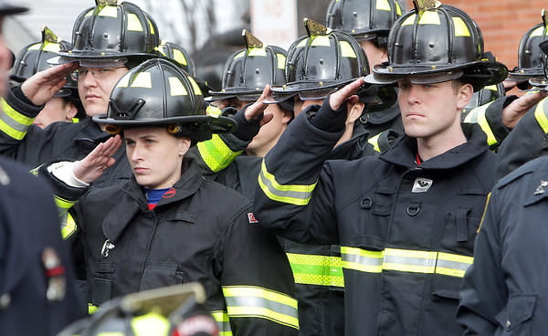 Peabody: Uniformed firefighters from local communities as well as across the country saluted as the casket of firefighter Jim Rice passes bye. David Le/Salem News
