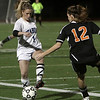 Peabody's Katie Brunelle (1) left, passes to a teammate around an Oliver Ames defender on Tuesday night. David Le/Salem News
