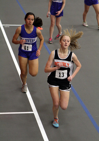 Beverly: Beverly's Jess Goodall and Danvers' Stephanie Kowalski battle for first place in the 1000m run on Thursday. David Le/Salem News