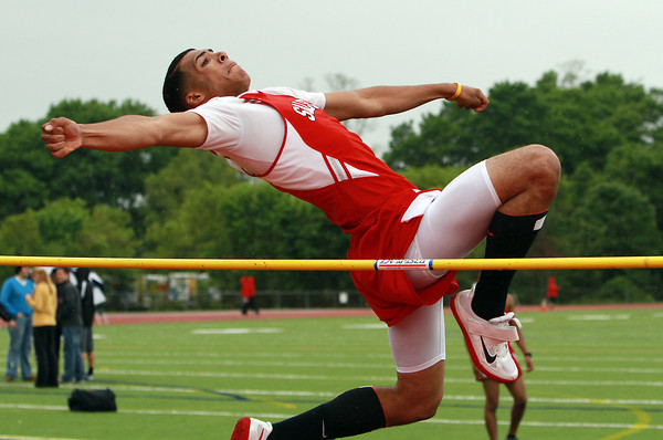 Salem junior Ben Sattiewhite leaps and clears the high jump bar in a meet against Beverly on Tuesday afternoon. David Le/Staff Photo
