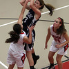 Swampscott's Niki Laskaris (23) center, shoots despite being covered by two Salem defenders. David Le/Salem News.