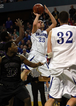 Danvers junior Nick McKenna (23) center, was a spark for the Falcons in the second half, scoring 15 of his 17 points in the Falcons' victory over St. Joseph's to capture their first ever state championship. David Le/Staff Photo