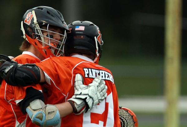 Beverly's Ryan Williams, left, gets congratulated on his goal by teammate Brenden Mitchell, against Danvers on Thursday. David Le/Staff Photo