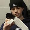 St. John's Prep _____________ slowly wraps white tape around the blade of his stick prior to engaging in pregame warmups. David Le/Staff Photo