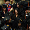 Salem State graduate Brianna Ingemi, of Danvers, center, waves to her family and friends before the start of Commencement Ceremonies on Saturday afternoon. David Le/Staff Photo