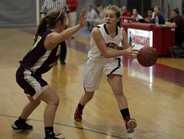 Marblehead's Mia Bongiorno (11) right, looks to pass against Gloucester. David Le/Salem News