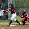 Beverly senior captain Jenna LoVasco makes contact and lines a base hit against Salem. David Le/Staff Photo