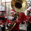 Alexis McTaylor, of the Salem High School Marching Band, plays her tuba while marching in the annual Beverly Holiday Parade on Sunday. David Le/Salem News